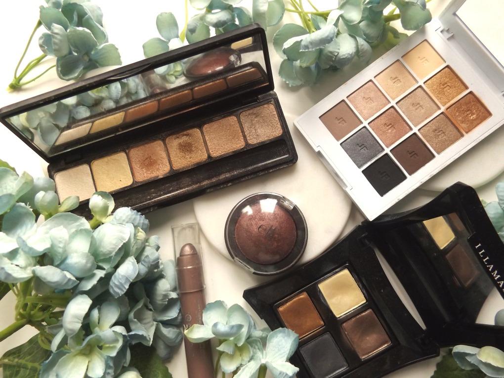 Clockwise: ELF prism palette in bronze, Joe Fresh neutrals, Illamasqua palette, ELF baked eyeshadow, Essence eyeshadow stick in mauve.