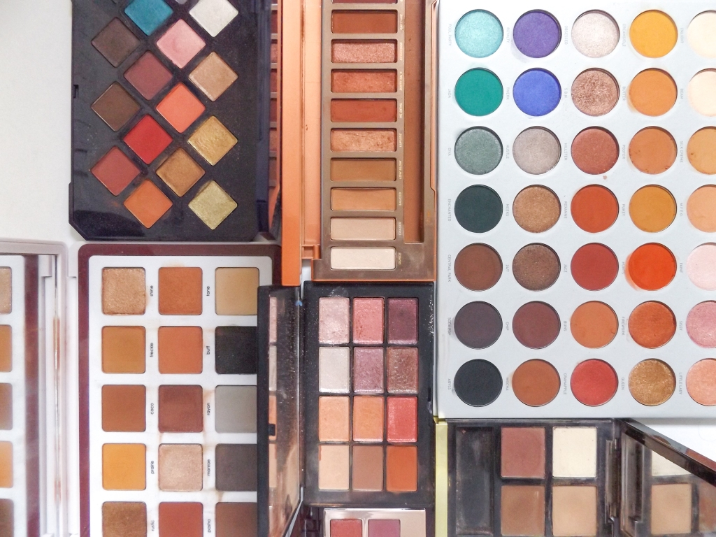 Palettes laid out: Clockwise- Fenty, Naked Heat, Morphe Jaclyn Hill. Tom Ford, Charlotte Tilbury, NARS Ignited,